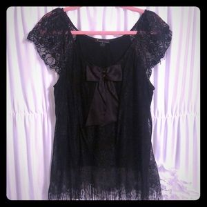 Black lace and bow detail top, size L.